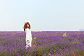 Red-haired white woman on a lavender field, — Stock Photo