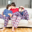 Stock Photo: Mother and son in pajamas