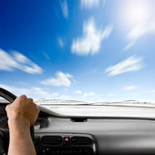 Steering wheel of a car and sky background — Стоковое фото