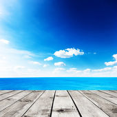 Beauty seascape under blue clouds sky. View from wood pier — Stock Photo