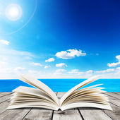 Sea and open book — Stock Photo