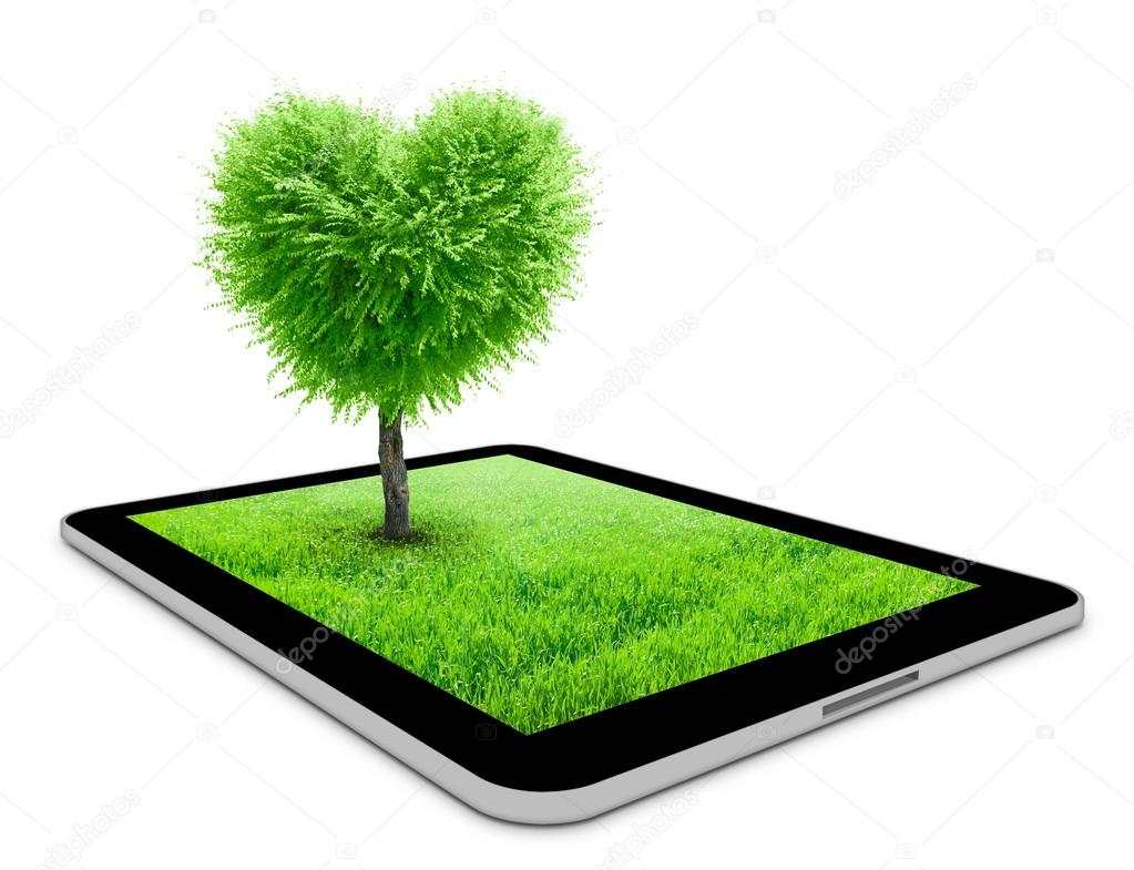 Black tablet with field and heart shape tree on it. Love concept background — Stok fotoğraf #18753131
