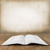 Open book on wood table over grunge background — Foto de Stock