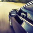 Blurred road and car, speed motion background — Stock Photo #38240021