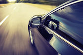 Blurred road and car, speed motion background — Stock Photo