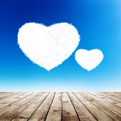 Blue sky with hearts shape clouds — Stock Photo