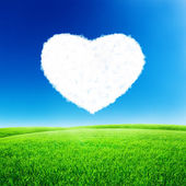 Blue sky with heart shape — Stock Photo