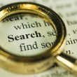 Search And Find Concept With Closeup Golden Magnifying Glass — Stock Photo