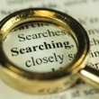 Searching Concept With Closeup Golden Magnifying Glass — Stock Photo