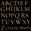 A large number of 3d Gold alphabet spelling art array — Stock Photo #12873012