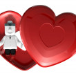 3d medical doctor lying in red heart box. 3D Square Man Series. — Stock Photo #49315615