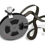 3d Businessman on Movie films spool with film. 3D Square Man Ser — Stock Photo #49316279
