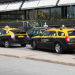 Stock Photo: Taxis - hybrid and normal