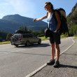 female hitchhiker — Stock Photo