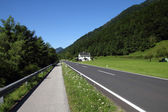 Road and bicycle path — Stock Photo