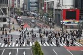 Commuters hurry on May 11, 2012 in Shibuya, Tokyo. — Stock Photo