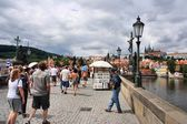 People visit Charles' Bridge on August 3, 2008 in Prague, Czech Republic. — Stock Photo