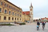Tourists visit main square — Stockfoto