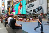 People visit Times Square on July 3, 2013 in New York. — Stock Photo