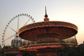Amusement park at night - ferris wheel and carousel — ストック写真