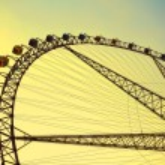 Ferris wheel against the blue sky — Stock Photo #25972281