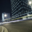 The highway car light trails of modern urban buildings — Stock Photo