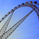 Ferris wheel against the blue sky — Stock Photo #25973757