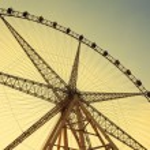 Ferris wheel against the blue sky — Stock Photo #25974181