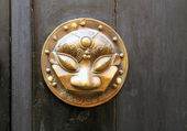 Bronze sculpture on the door Mask — Stock Photo