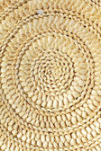 Chinese reed leaves woven spiral shape crafts of background — Stock Photo