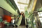 Modern steps of moving business escalator — Stock Photo
