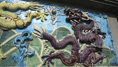 Purple Chinese dragon of ancient ceramics — Stock Photo