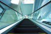 Modern architecture steps of moving business escalator — Stockfoto
