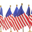 United States of America flags hanging on the gold flagpole — Stock Photo