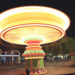 amusement park at night - carousel — Stock Photo