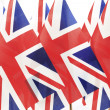 United Kingdom flags hanging in the queue on flagpole — Stock Photo #27601823