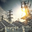 Solar energy panels and Power transmission tower — Stock Photo