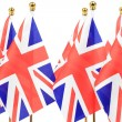United Kingdom flags hanging on the gold flagstaff — Stock Photo #27602051