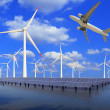 Aircraft is flying in eco power of wind turbines and solar panel — Stock Photo