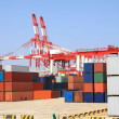 Port cranes and container trade — Stock Photo #27602731