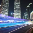 The light trails on the modern building background in shanghai — Stock fotografie