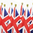 United Kingdom flags hanging on the gold flagpole — Stock Photo #27602843