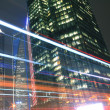 Modern office building background of car night with light trails — Стоковая фотография