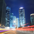 Urban night traffics view in dusk. Focus on the road — Stock Photo
