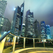 Stock Photo: Looking up at modern office buildings at night in Shanghai