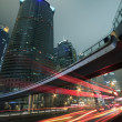 Urban at night with traffic and night skyline in shanghai — Stock Photo