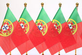 Portugal flags hanging on the gold flagstaff — Stock Photo