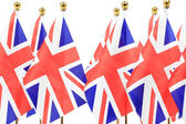 United Kingdom flags hanging on the gold flagstaff — Stock Photo