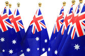 Flags of Australia hanging on the gold flagstaff — Stock Photo