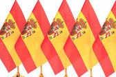 Spain flags hanging on the gold flagstaff — Stock Photo